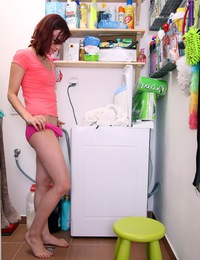 A clothes washing teenager plays with her young titties