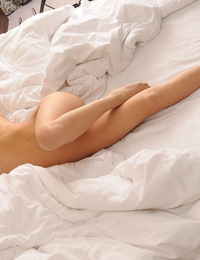 Aria,The Morning After,Aria awakes in bed completely nude and seductively stretches her perfect young body.