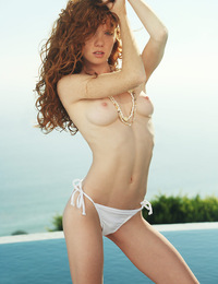 Scarlett,Getting Wet,Stunning redhead Scarlett slips out of the pool sheds her tiny bikini bottoms and shows off her slender body.